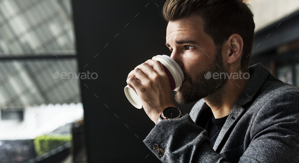 Side view of mna drinking hot coffee - Stock Photo - Images