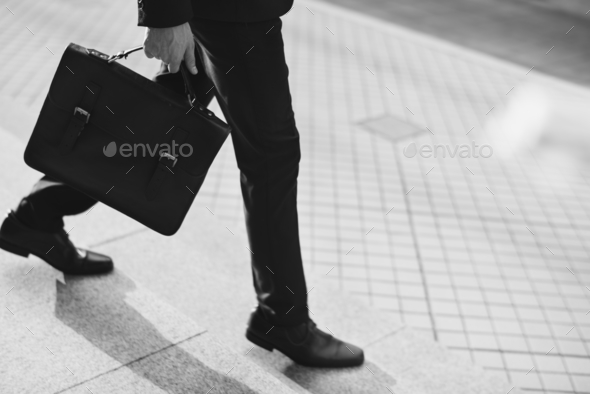 Business man going for a meeting - Stock Photo - Images