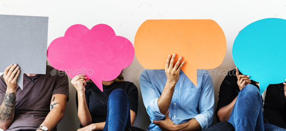 Group of diverse people with speech bubbles icons - Stock Photo - Images