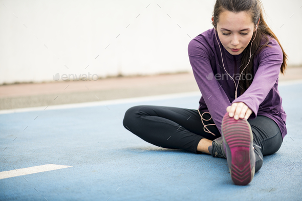 Woman stretching before exercise - Stock Photo - Images