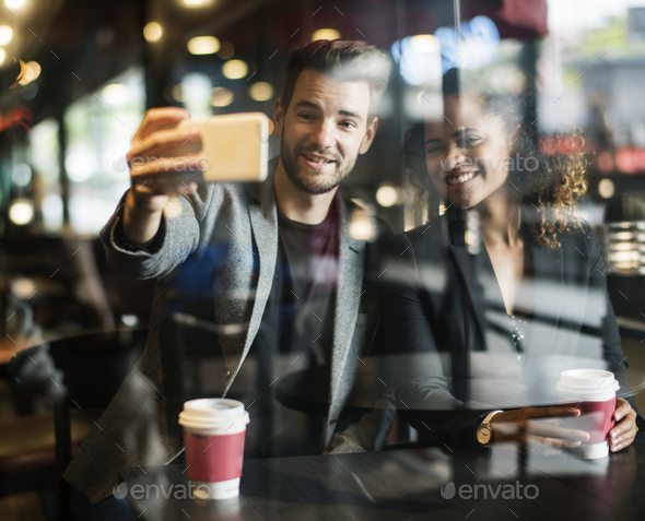 Couple at a coffee shop - Stock Photo - Images