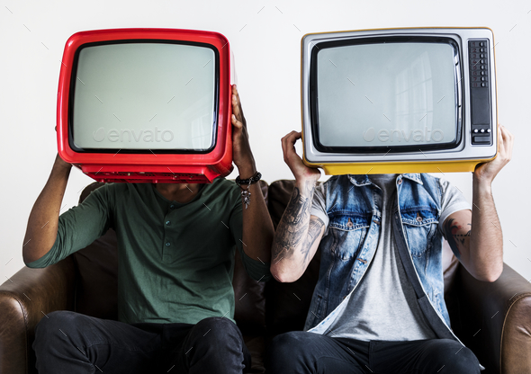 People holding retro television next to each other - Stock Photo - Images