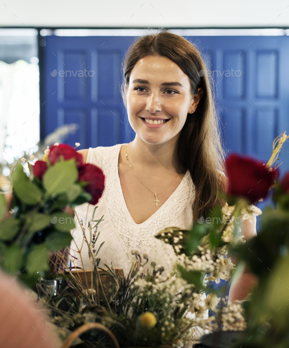 Woman in the flower shop - Stock Photo - Images