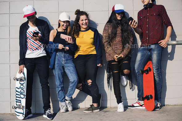 Group of teenage friends outdoors lifestyle and social media concept - Stock Photo - Images