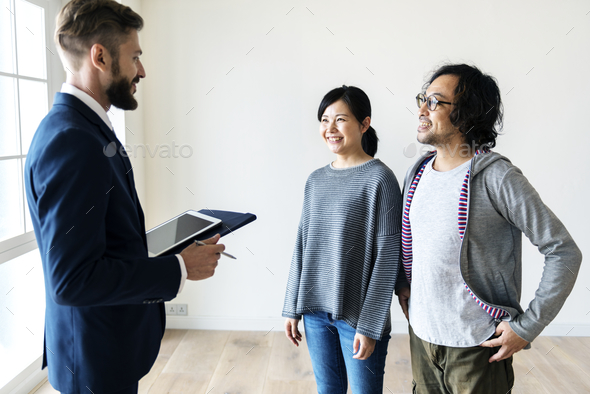 Asian family buy new house - Stock Photo - Images