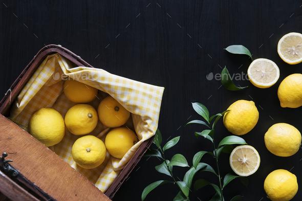 Fresh yellow lemons on black background - Stock Photo - Images