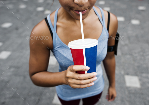 Sporty person drinking a beverage - Stock Photo - Images