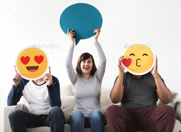 Group of diverse friends sitting on couch with emoticon internet and connection concept - Stock Photo - Images