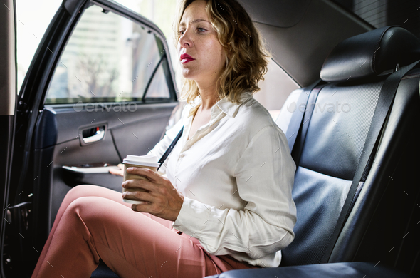 Woman sitting in a car - Stock Photo - Images