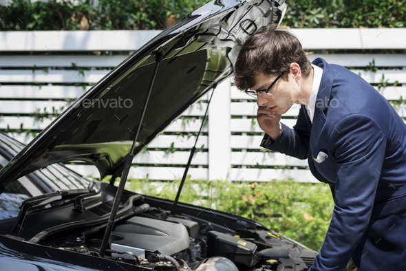Man calling for help to fix his car - Stock Photo - Images