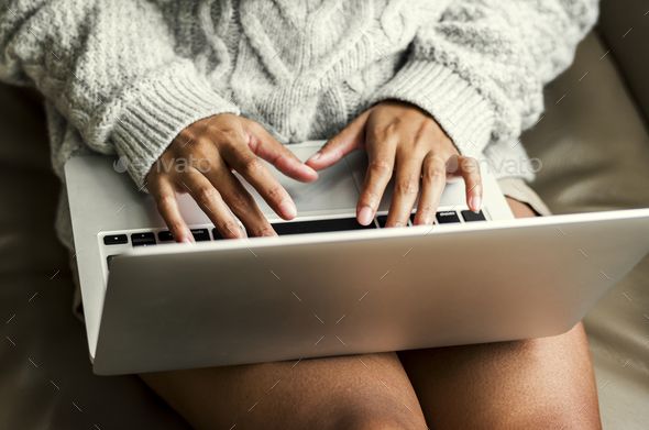Woman working on a laptop - Stock Photo - Images