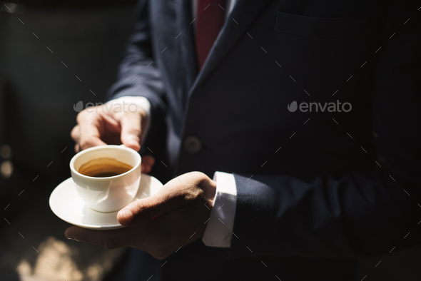 A businessman  having coffee - Stock Photo - Images