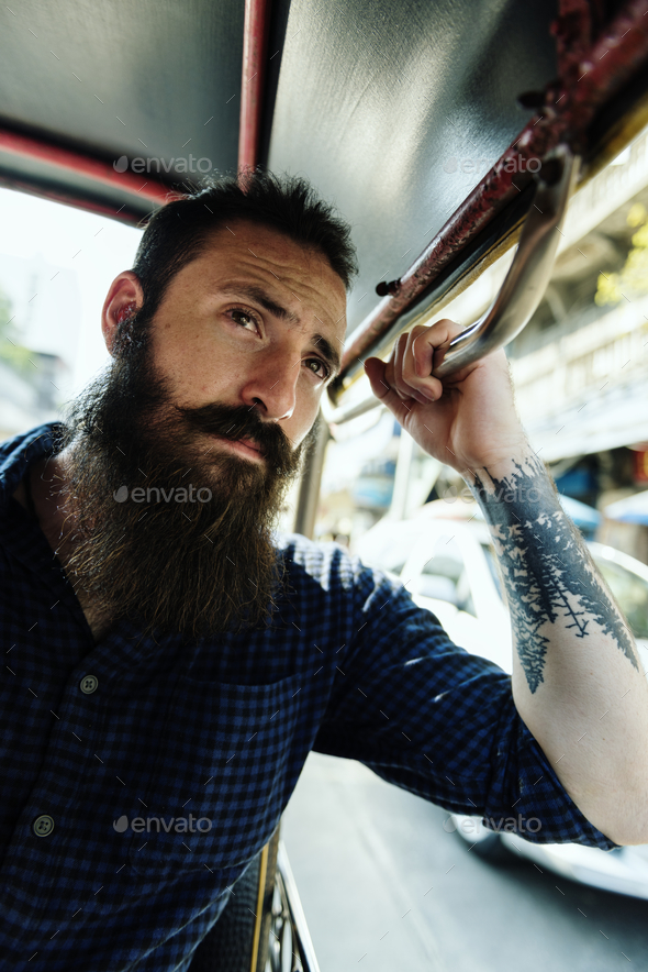 Hipster man riding a public transport - Stock Photo - Images