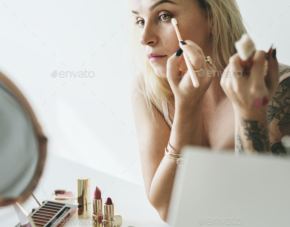 Beauty blogger doing makeup tutorial - Stock Photo - Images