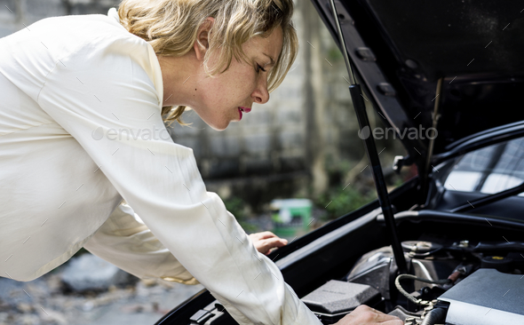 Trying to fix the car - Stock Photo - Images