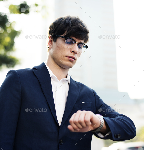 Business man looking at the watch - Stock Photo - Images
