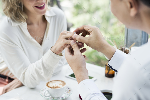 Man proposing girlfriend with diamond ring - Stock Photo - Images