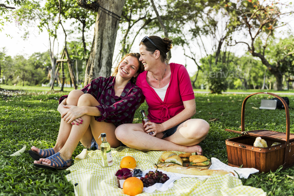 Mother and daughter having a picninc in the park - Stock Photo - Images
