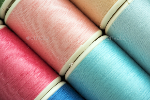 Colorful sewing threads background closeup - Stock Photo - Images