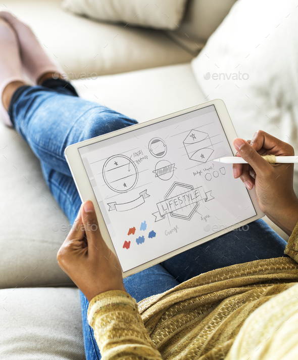 Woman designing banner icon on digital tablet - Stock Photo - Images