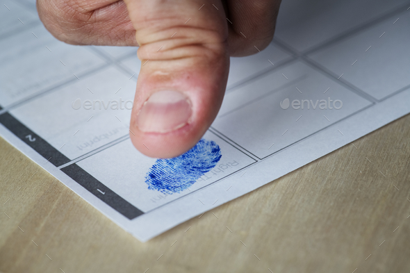 Closeup of fingerprint on paper - Stock Photo - Images