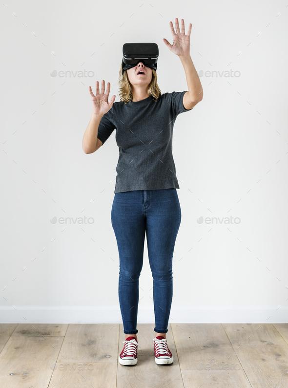 White woman enjoying VR - Stock Photo - Images