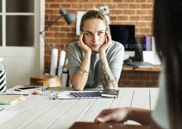 Caucasain woman with thoughful face expression - Stock Photo - Images
