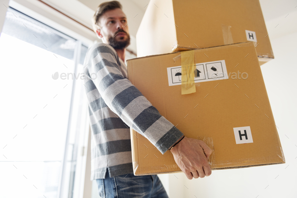 Man moving to new house - Stock Photo - Images