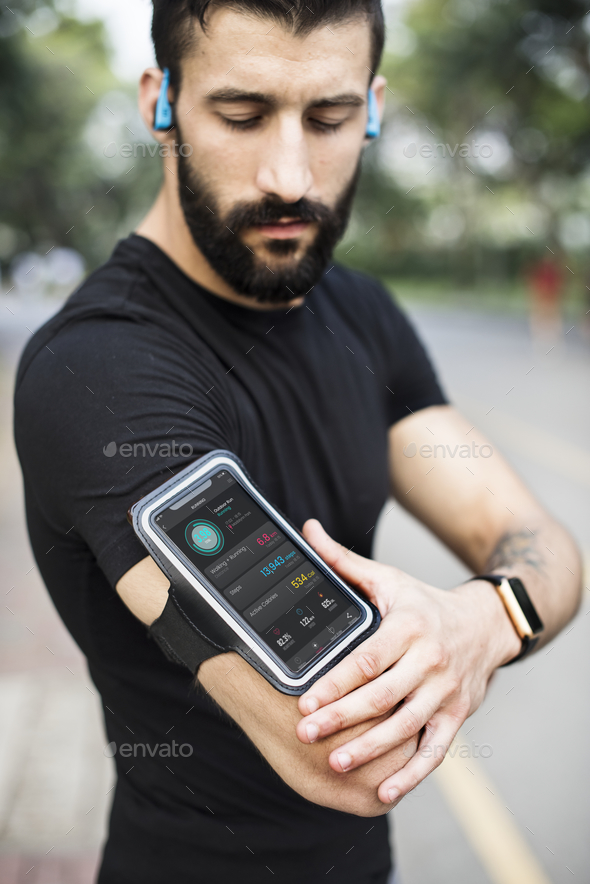 A man wearing a smartphone armband - Stock Photo - Images
