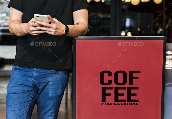 Young man waiting at a coffee shop - Stock Photo - Images