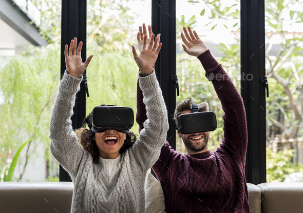 Young couple using VR together - Stock Photo - Images