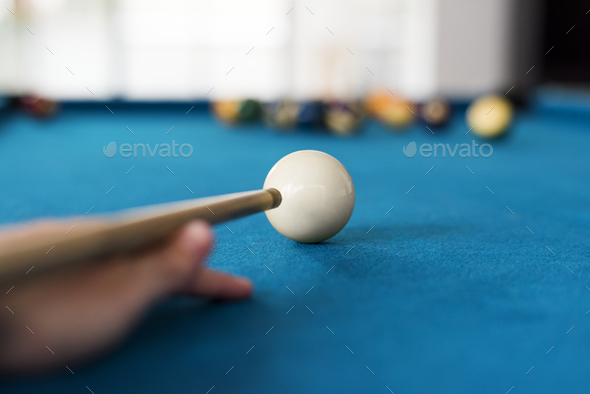 Man playing pool by himself - Stock Photo - Images