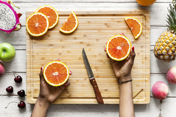 Cutting up healthy fresh oranges - Stock Photo - Images