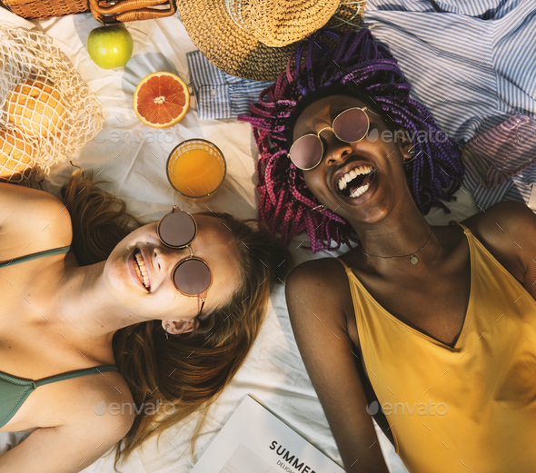 Cheerful girls in swimsuit sun tanning together - Stock Photo - Images