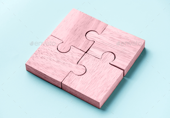 Jigsaw teamwork concept macro shot - Stock Photo - Images