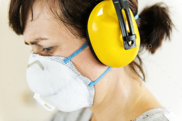 Woman wearing ear protection - Stock Photo - Images