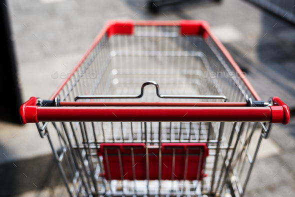 Empty shopping trolley left outside - Stock Photo - Images