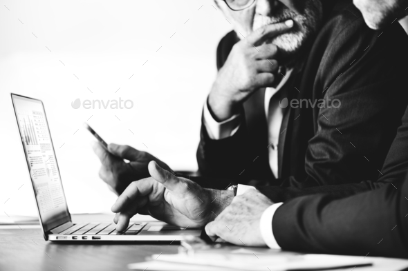 Businessmen using computer laptop - Stock Photo - Images