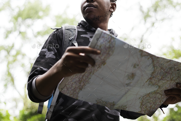 Map checking in the forest - Stock Photo - Images