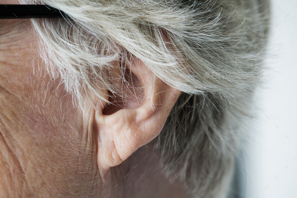 Closeup of elderly woman's ear - Stock Photo - Images