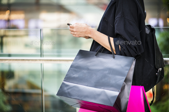 Girl carrying a alot of shopping bags - Stock Photo - Images
