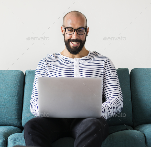 Man using laptop for work - Stock Photo - Images