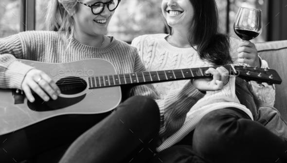 Women enjoying the music together - Stock Photo - Images