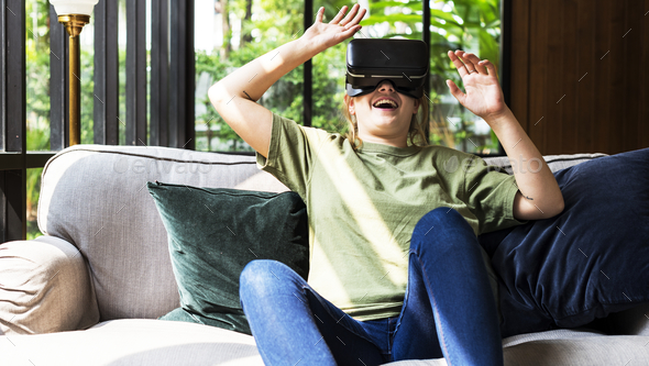 People enjoying virtual reality goggles - Stock Photo - Images