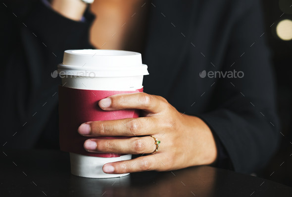 Woman holding a cup of coffee - Stock Photo - Images