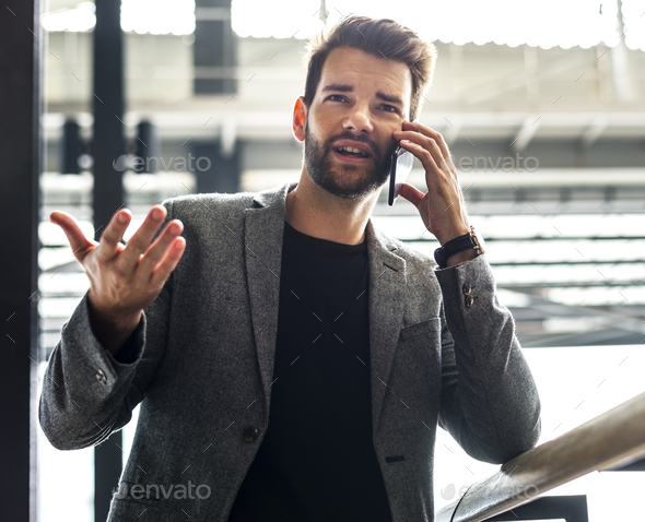 Man is talking on the phone - Stock Photo - Images