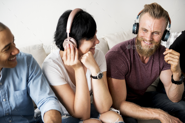 People enjoy music on headphones - Stock Photo - Images