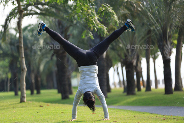 Handstanding at tropical park - Stock Photo - Images