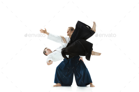 The two men fighting at Aikido training in martial arts school - Stock Photo - Images
