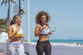 Content women jogging in tropical sunshine - PhotoDune Item for Sale